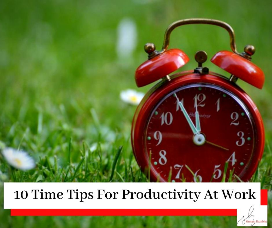 A red alarm clock on a field of grass with the titlle 10 Time Tips For Daily Productivity At Work
