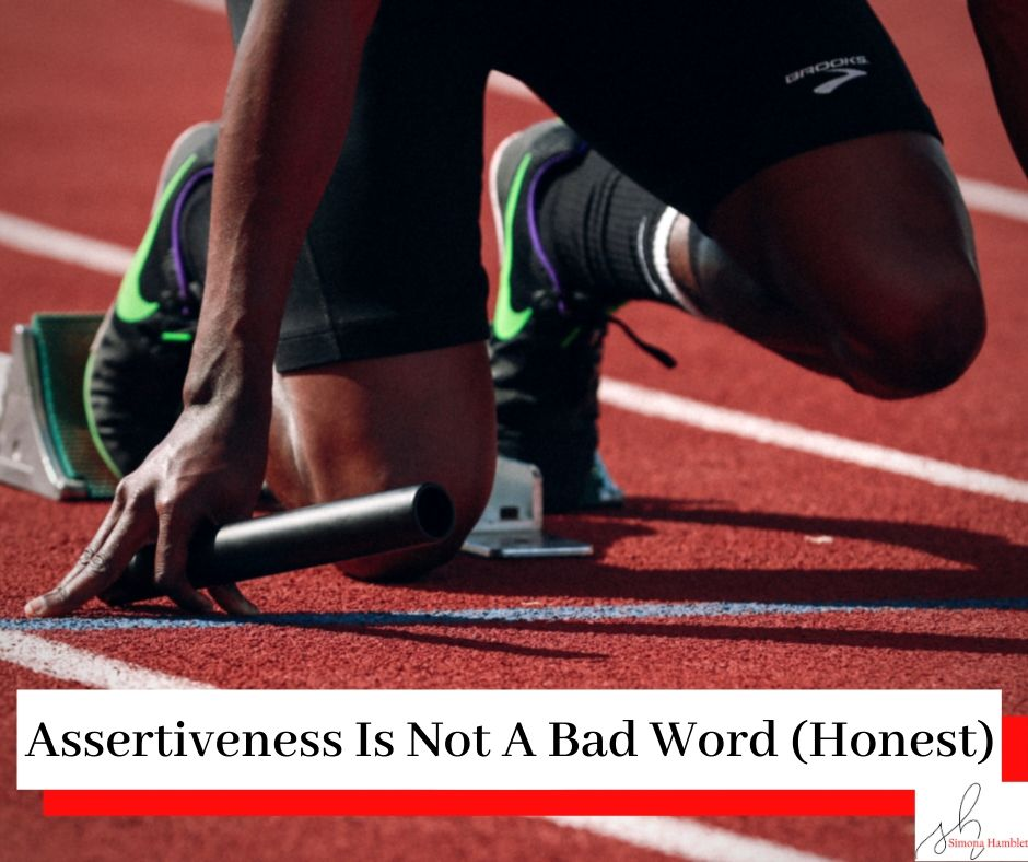 Picture of a runner on a race track with the title Assertiveness Is Not A Bad Word (Honest)