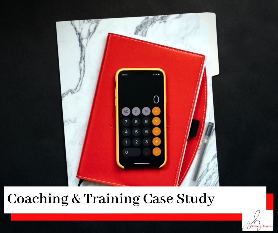 Red book and pen and calculator with title Coaching & Training Case Study