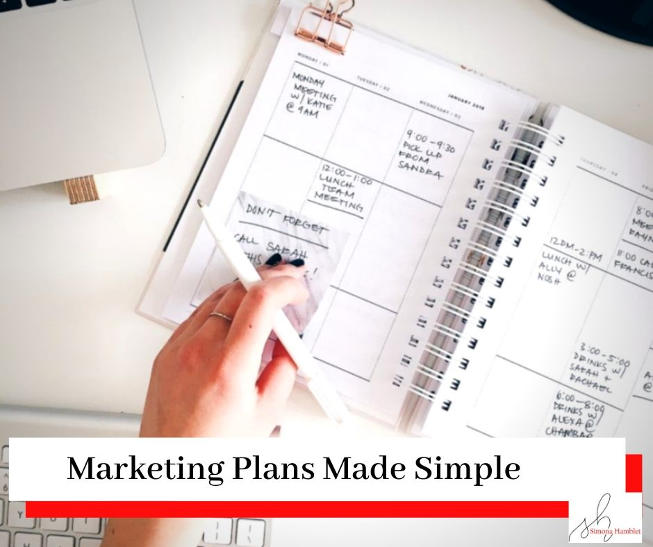 Person writing in a diary with title Marketing Plans Made Simple