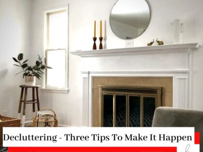 A white, clean, clear, and tidy lounge with a fireplace and a mirror with the title Decluttering - Three Tips To Make It Happen