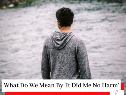 Man in grey sweatshirt looking out over the water with a title What Do We Mean By 'It Did Me No Harm'