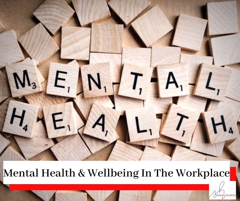 The words Mental Health written on wooden cubes like in scrabble and the title Mental Health & Wellbeing in the Workplace