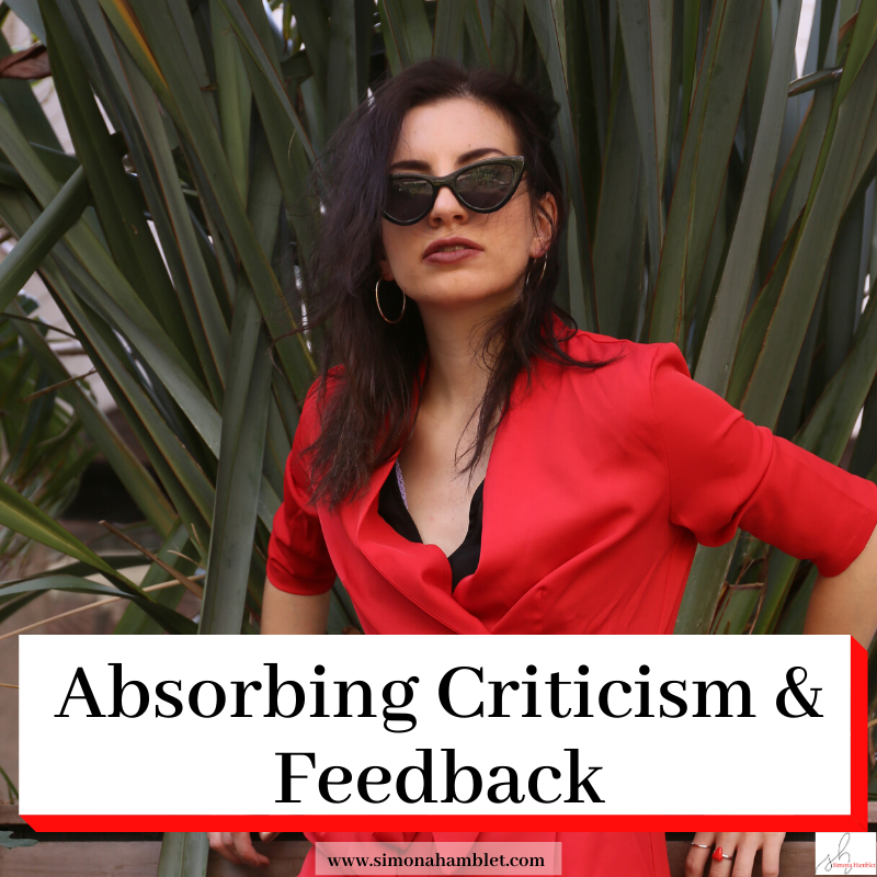 Female with title Absorbing Criticism & Feedback