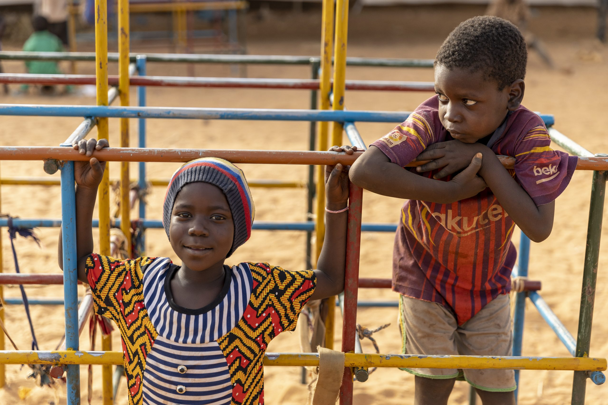 3 March 2020 - Kaya, Burkina Faso. Children playing in a playground set up by UNICEF in Bolle Idps site in Kaya.  Since the beginning of 2019, an intensification of attacks in Burkina Faso has provoked a rapid increase in the number of internally displaced persons (IDPs). More than 80,000 were displaced in the commune of Kaya (March 2020).   Burkina Faso is currently the world's fastest-growing displacement crisis with close to 840,000 people have been displaced by conflict and drought in the last 16 months (March 2020).  Despite the increased deployment of security forces, armed groups continue to wreak havoc in the country's Centre Nord and Sahel regions, attacking police and military, civilians, schools, health centres, teachers and health workers alike. UNHCR staff are regularly hearing harrowing accounts from survivors on the run. People speak in horrifying details of attacks on their villages, where men and boys are killed, women raped, homes pillaged and schools along with other infrastructure are destroyed.  UNICEF / Aurélia Rusek