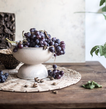 Bowl with grapes styled on a vintage table Oil on paper blog creative living can you earn money by doing what you love