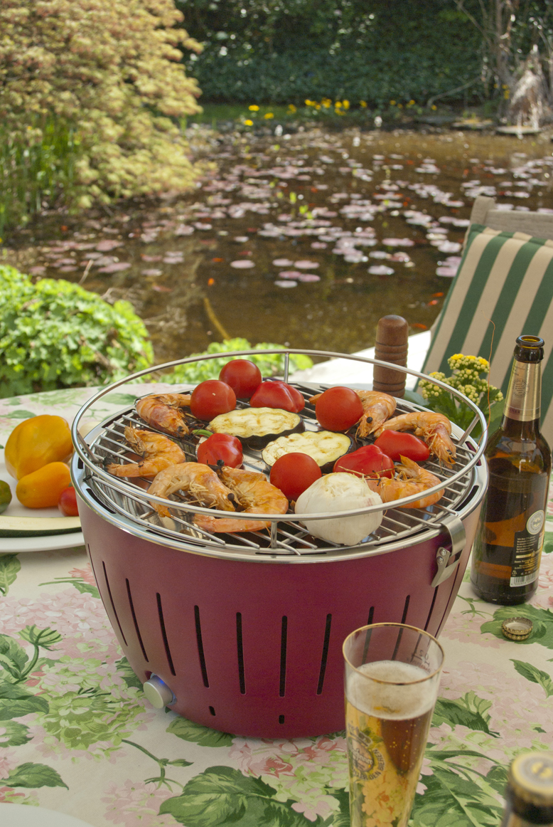 Red LotusGrill Barbecue cooking veg and prawns to perfection