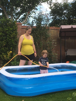 Willow filling up the paddling pool