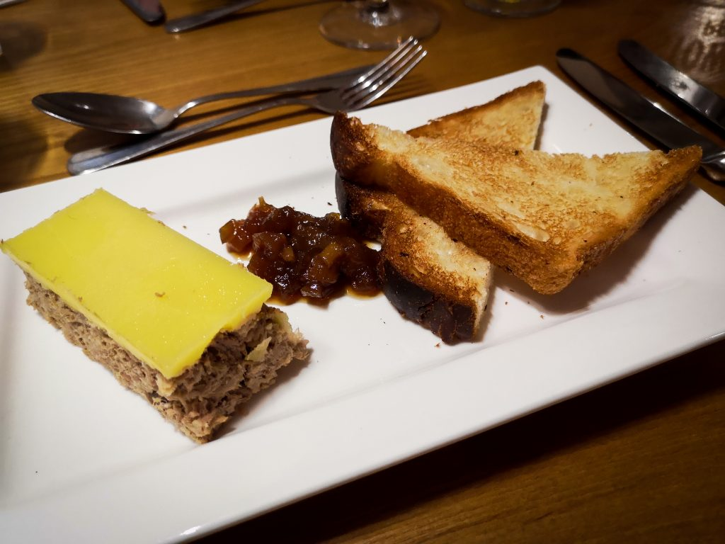 Rabbit rillette pate served with apricot chutney and brioche toast