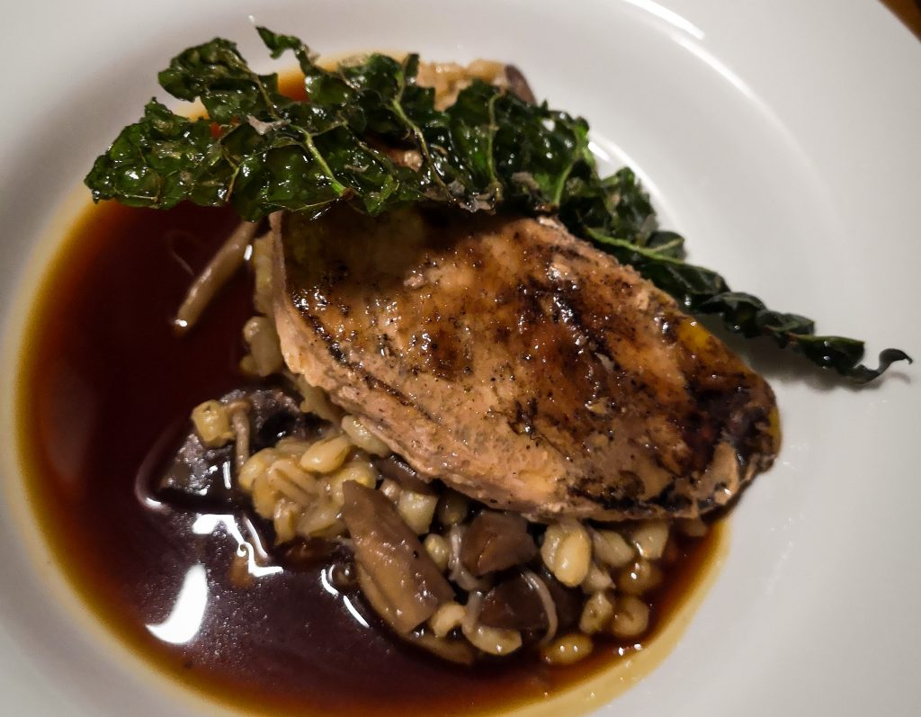 Pheasant dish full of pearl barley, wild mushrooms and crispy kale