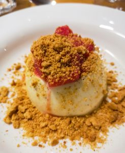 Creamy vanilla pannacotta with forced rhubarb and ginger nut crumb