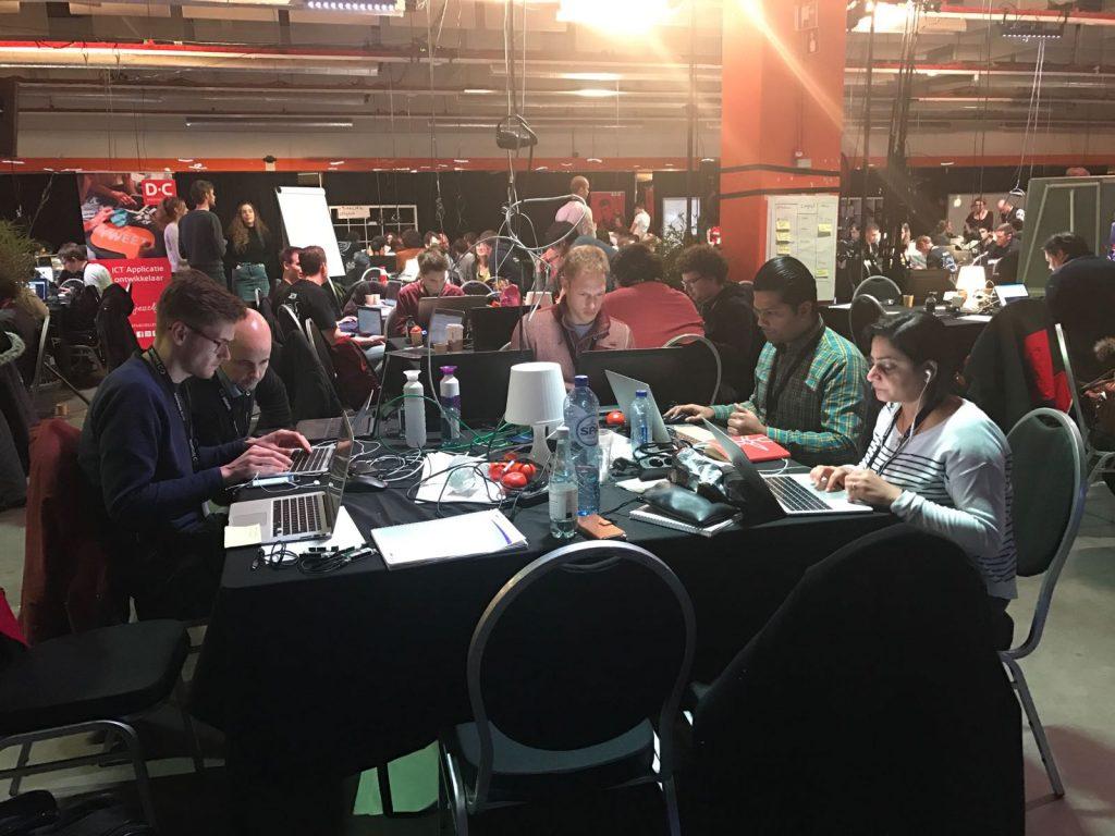 Working hard during the Blockchain Hackathon