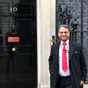 Anand Samani standing in front of 10 Downing Street in London