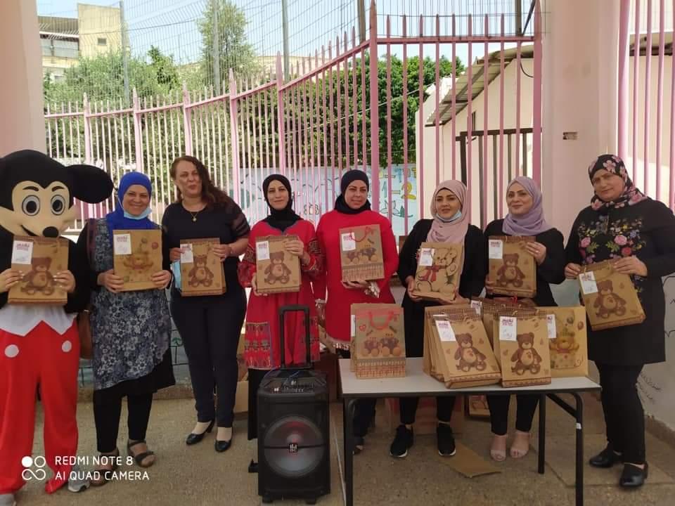 Holidays' presents distribution to school children of Tamra