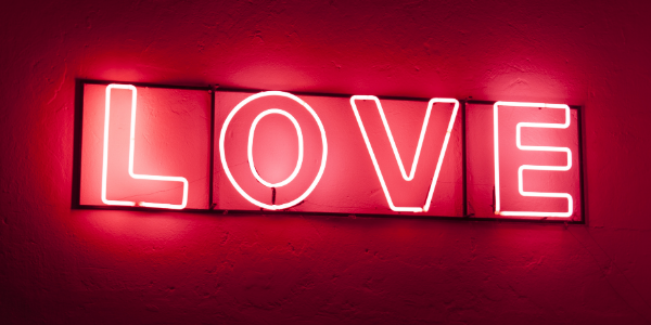 A red neon sign that spells LOVE