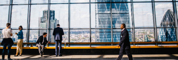 Executives in London looking over the city from a window