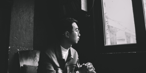 A young man looking out of a window
