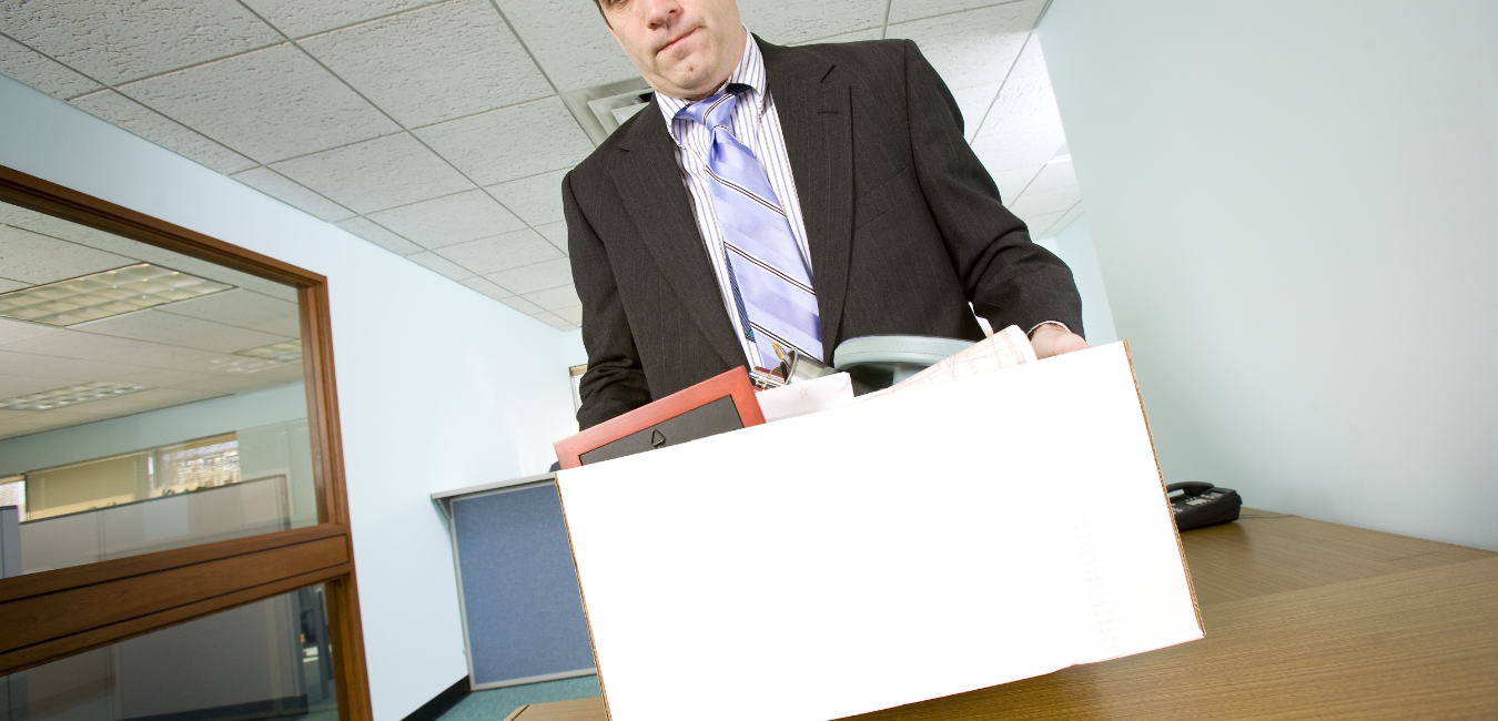 A man with a box of office equipment