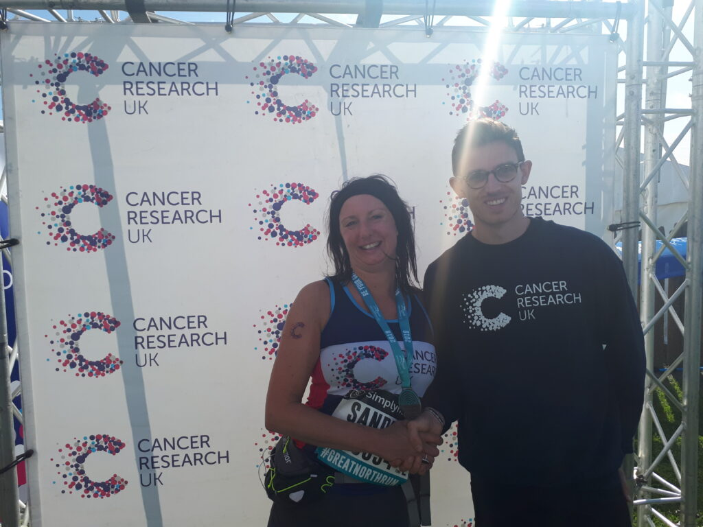 Sandra Cowham with a representative from Cancer Research UK after completing The Great North Run.