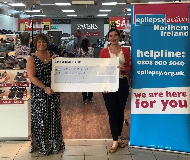 Gillian Mallon Customer Advisor at Pavers in Bloomfields handing over the cheque to Clare Watson from Epilepsy Action NI.