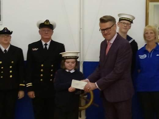 Robert Abbott Store Manager at Pavers Brighton, handing the donation cheque over to T.S Nautilus.