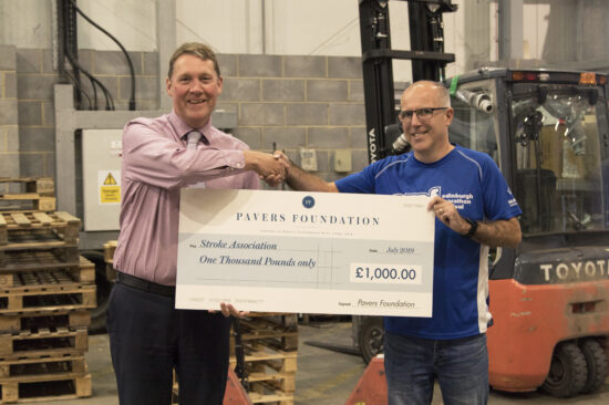 Mark Granger, Director of Operations at Pavers handing over the cheque toKevin Atkinson, Warehouse Floor Manager at Pavers.