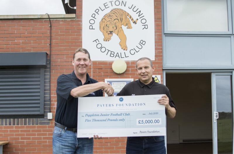 Mark Granger, Director of Operations at Pavers, handing the cheque over to Paul Bunce, Head of Distribution as Pavers and a member of the Poppleton Junior Football Club committee.