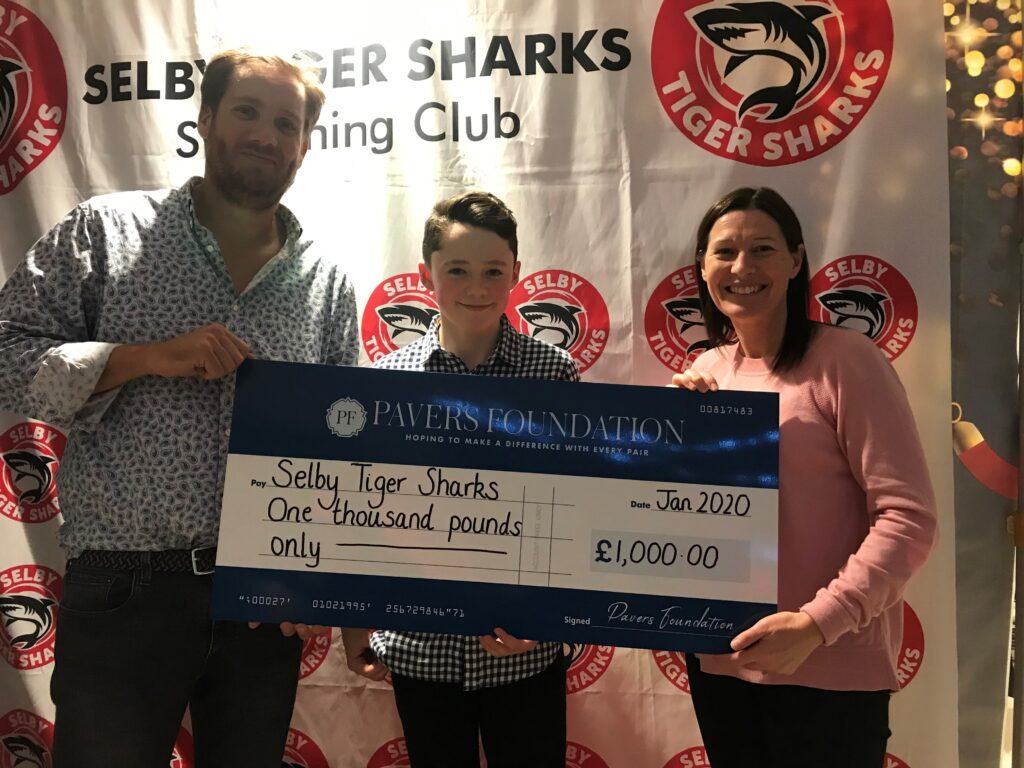 Andy Moore , Chairman of Selby Tiger Sharks with Alex McCallum, Junior Captain and Tina Pinder, Head of HR at Pavers Head Office in York.