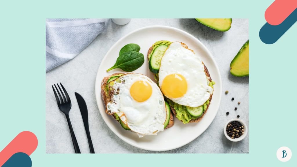 Savoury breakfast of eggs and avocado on wholemeal bread as food to reduce stress and increase energy