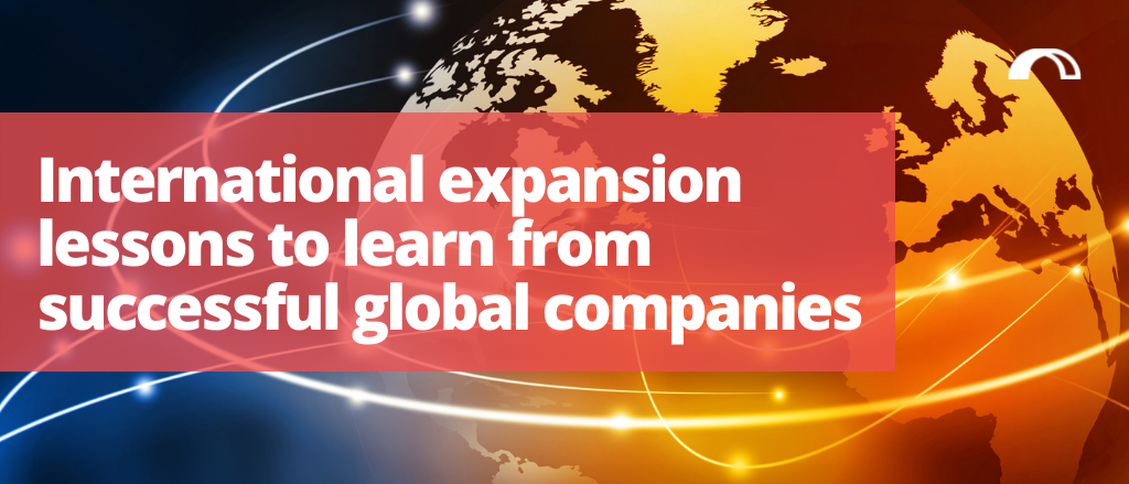 """""""International expansion lessons to learn from successful global companies"""" blog title, surrounderd by an image of the world with lines flying around it to signify connection between regions and expansion"""