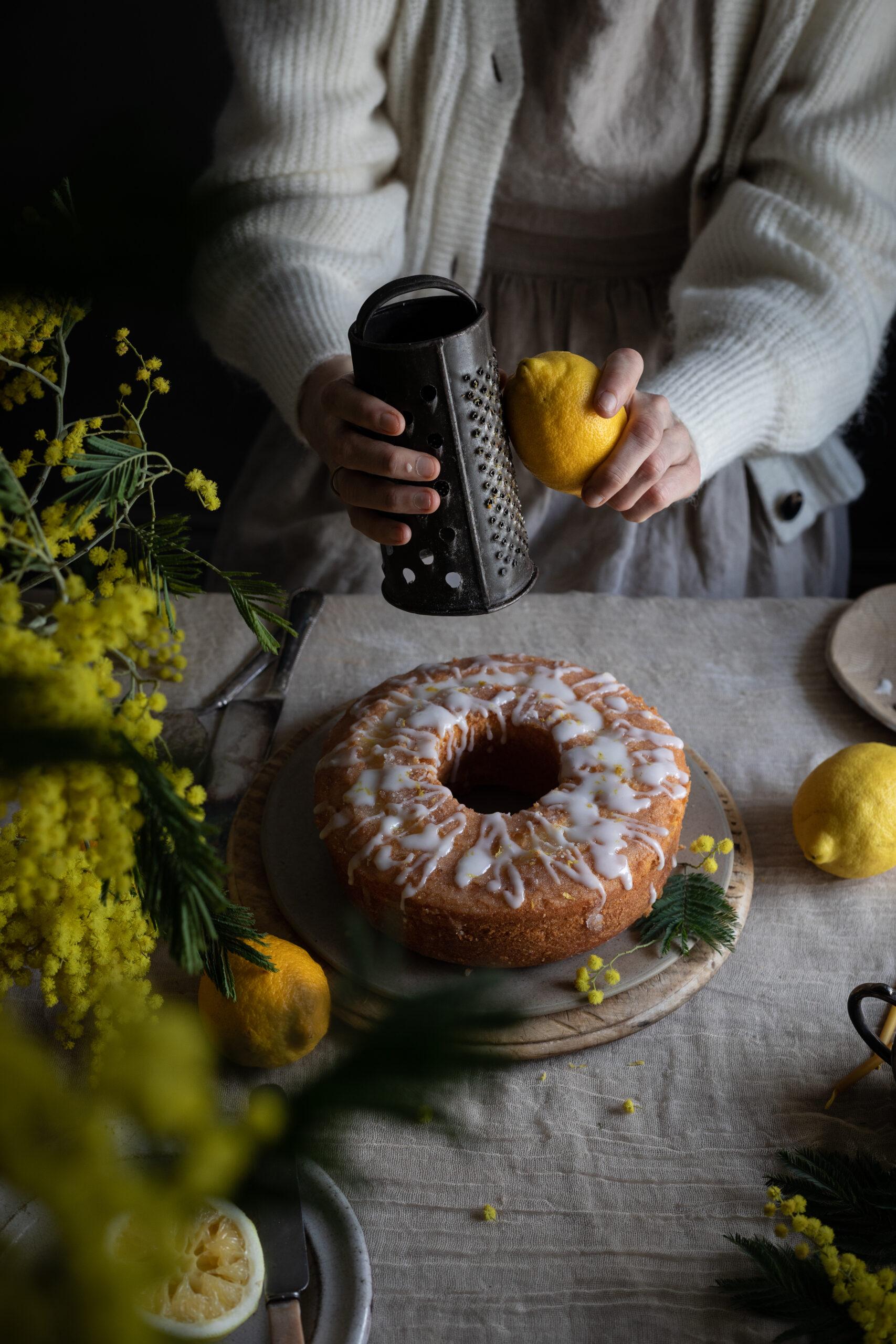 grating lemon on cake