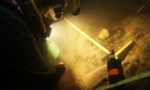 Divers investigate the Page-Ladson archaeological site in Florida