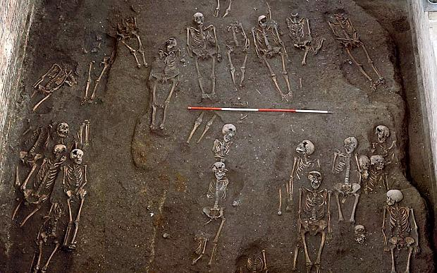 Undated St John's College, University of Cambridge, handout photo showing part of one of Britain's largest medieval cemeteries containing the remains of more than 1,000 people, which was unearthed under part of the University of Cambridge