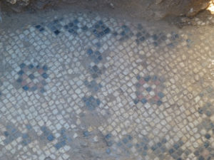 The mosaic floor is beautifully decorated with multiple stylized crosses and iconography.