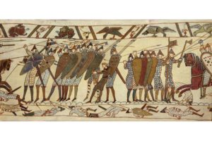 A section of the Bayeux Tapestry, an embroidered cloth depicting the Norman Conquest of England and the battle of Hastings in 1066.