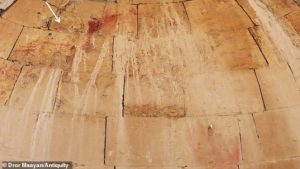 The fragmented painting shows is thought to be from the sixth century and experts claim it reveals Christ's facial outline and a youthful Jesus with short hair