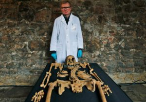 Don Walker, a human osteologist, with one of the skeletons found by construction workers under central London's Charterhouse Square