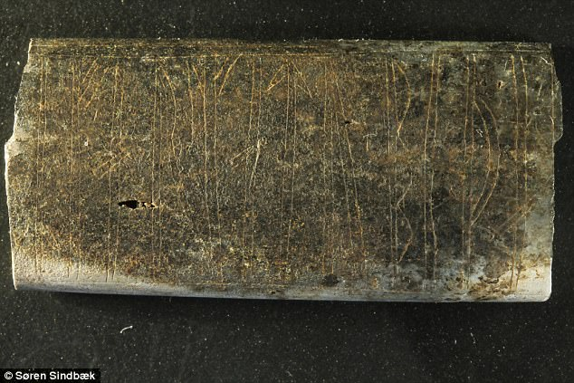 This bone plate was burnt and had degraded after more than 1,000 years in the ground. It measures just 3.8 by 1.8 centimetres