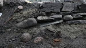 Archaeologists uncovered the foundations of a wooden church where the body of the Viking king Olaf Haraldsson may have been enshrined after he was declared a saint.