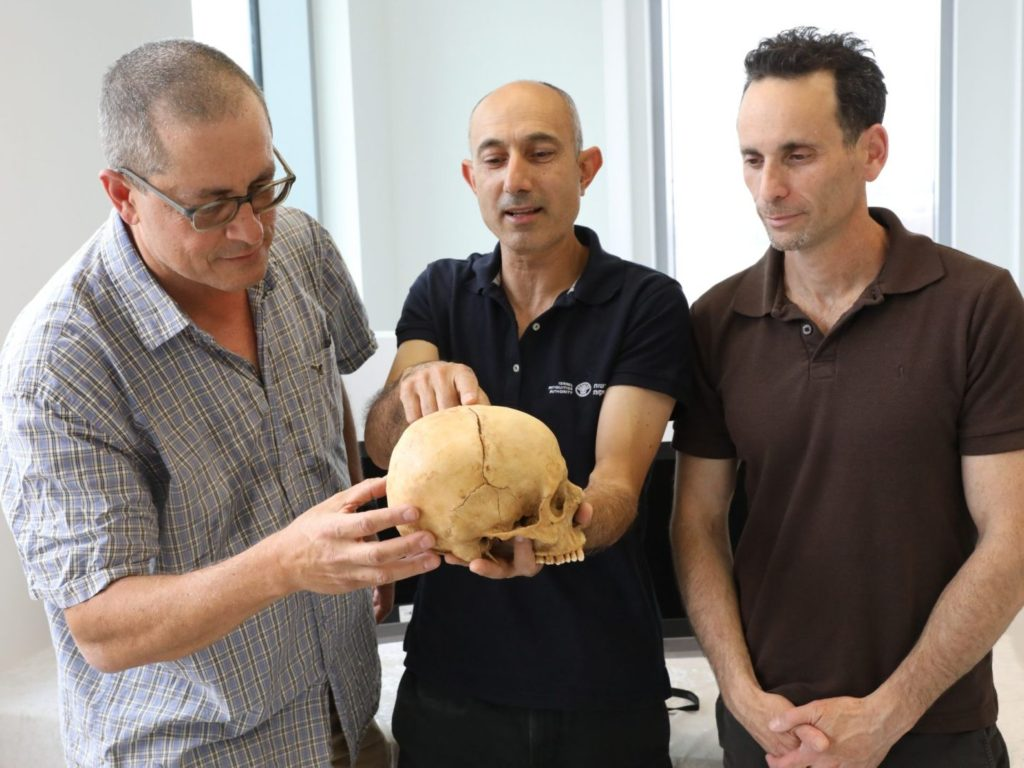 From left: Prof. Boaz Zissu, Dr. Yossi Nagar and Dr. Haim Cohen with the 1,000 year old skull