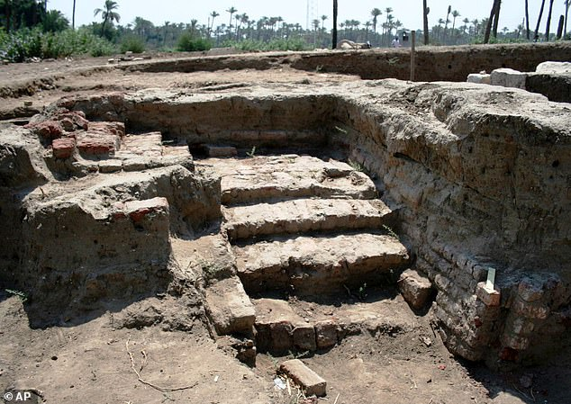 Pictured is a staircase found at the new site. Archaeologists have discovered a 'massive' ancient building in the Egyptian town of Mit Rahina, 12 miles (20km) south of Cairo