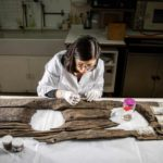 Conservator Luisa Duarte working on the 12th-century toilet seat.