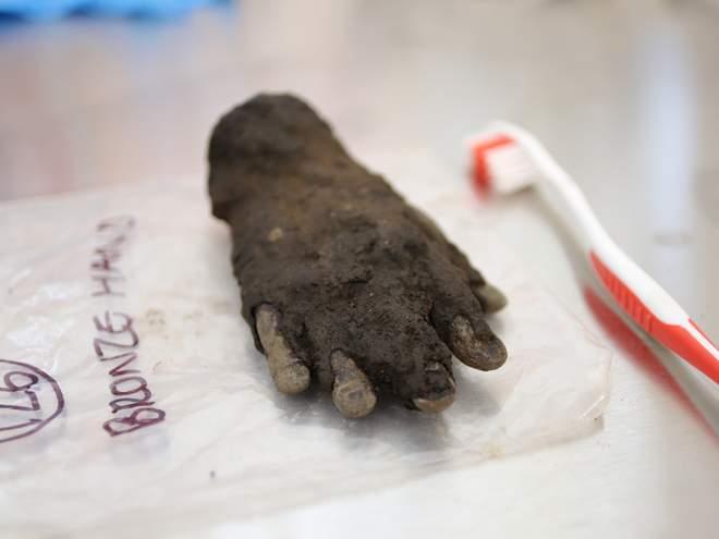 Bronze hand of the Roman god, Jupiter Dolichenus, before conservation