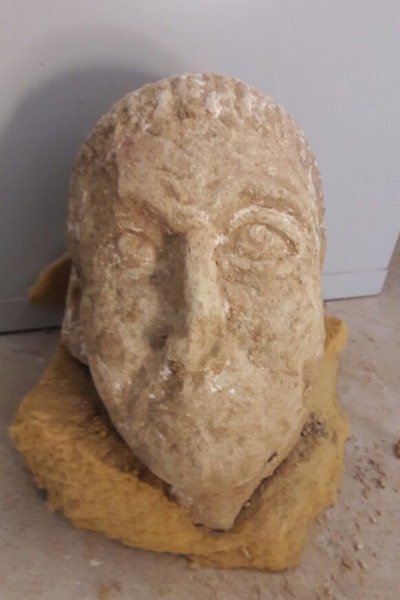 Head of a Graeco-Roman statue discovered at temple near Egypt's Siwa Oasis