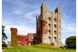 """Penrhyn Castle, Gwynedd. In 2012, the mystery of a curious piece of graffiti etched into one of the tower windows was revealed to read """"to be loved, whilst loving""""."""