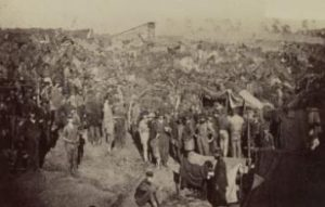 Federal prisoners of war await the distribution of their rations. Andersonville Prison, Ga., August 17, 1864