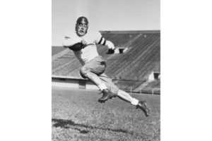 Jay Berwanger, halfback of the University of Chicago. After being picked in the first NFL draft, Berwanger chose to pursue a career in plastics manufacturing.