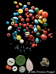 Buttons and beads were uncovered at the massacre site
