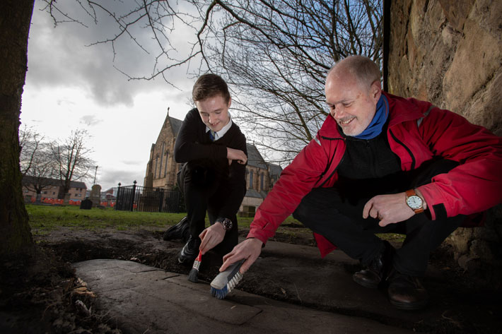 A 14-year-old schoolboy helping out at an archaeological dig in Glasgow has found one of a set of lost gravestones from the Middle Ages.