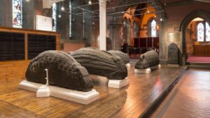 The collection of ornately-carved stones are from the Viking Age